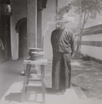 Fr. André Boland in a sedan chair near Lung Tsing