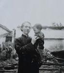 Fr. Léon Pardoen and little girl