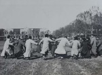 School boys dancing on the lawn in front of the bishop's residence by Fr. Charles Meeus
