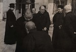 Bishop Jean-Baptiste Wang greeted by his priests upon his return from Beijing