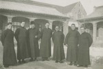 Chinese priests and Samists in the courtyard of the Xuanhua seminary