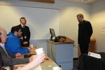 Fr. Maher introduces Dr. Wu