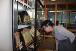 Joseph Ho viewing the exhibit