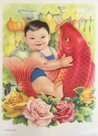 Young boy holding carp