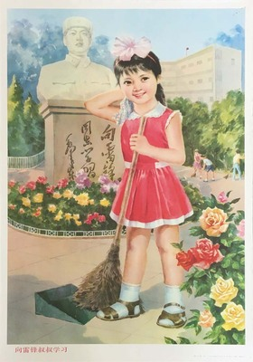 Young girl with broom in front of Lei Feng statue