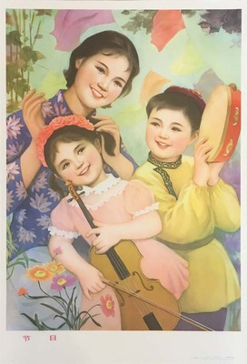 Two girls holding instruments and a woman