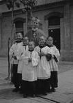 Archbishop Mario Zanin and Chinese altar boys.