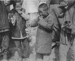 Young Catholic Children Eating Grapes