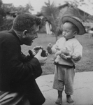 Fr. Kennelly, MM, Talking to a Young Chinese Child