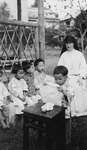 Maryknoll Sister Teaching Orphans