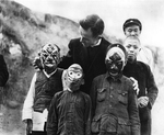 Maryknoll Missionary with Chinese Children in Opera Masks
