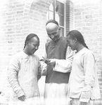 Fr. Anthony Cotta, MM, with Two Chinese Men