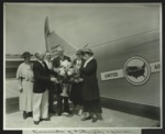 Conrad Bluhm with Father's Day sponsors next to airplane, c. 1935