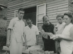 Father Alexandre Cao Lishan Distributing Food