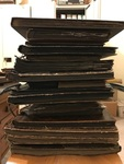 Stack of Samist photo albums